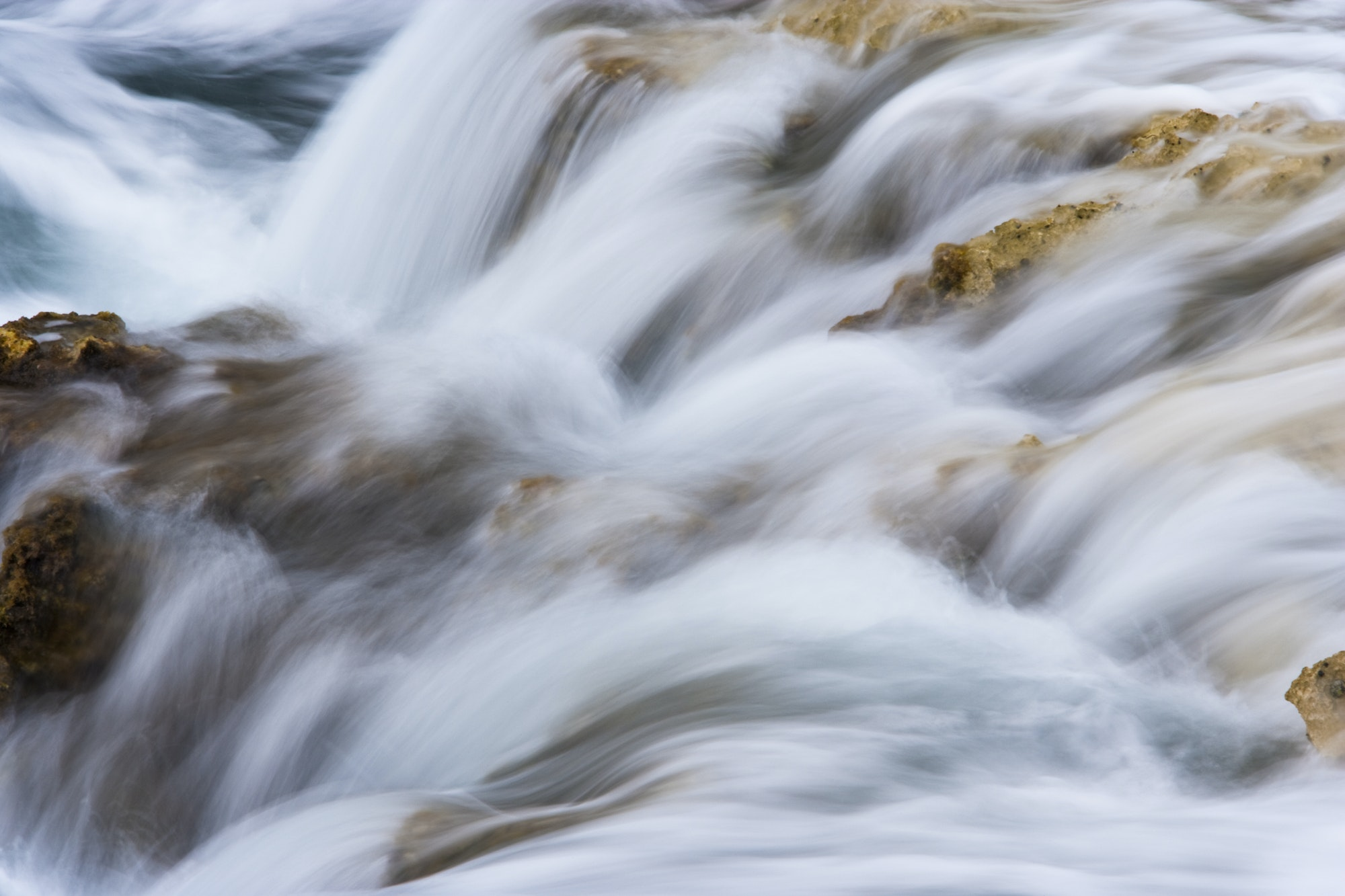 Sea water tides flowing over rocks, time lapse photography,